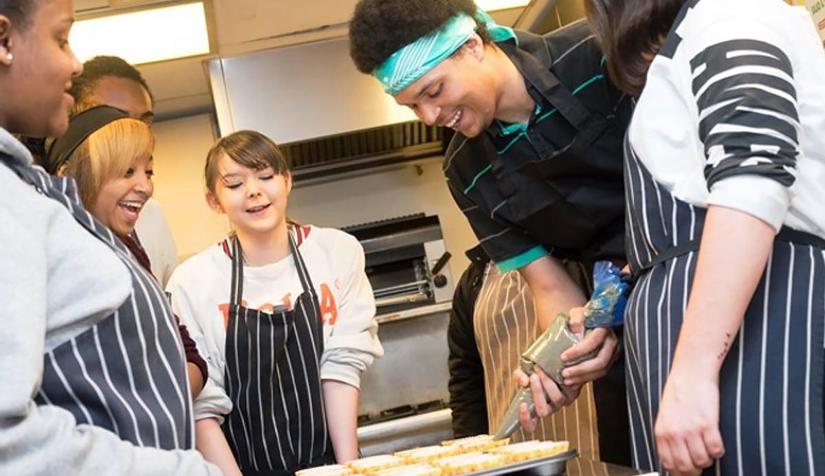 Children enjoying a cookery class, at Howard House School